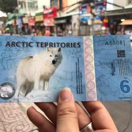 Tiền in hình con chó Bắc Cực